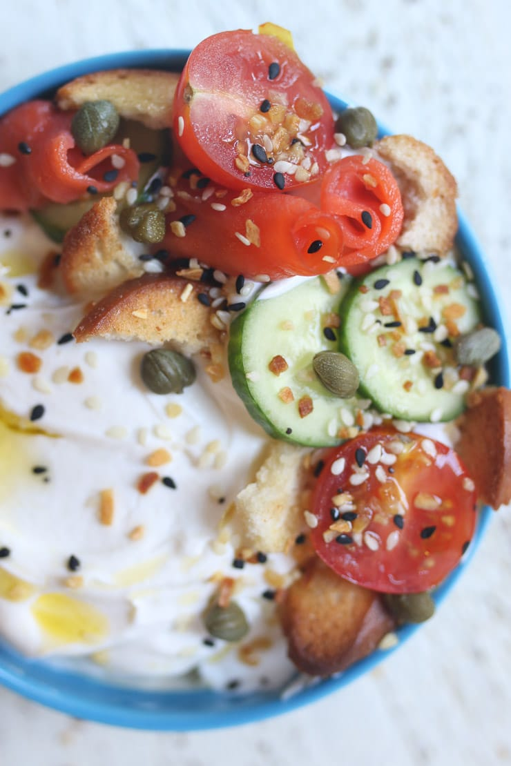 Yogurt bowl topped with smoked salmon and bagel chips.