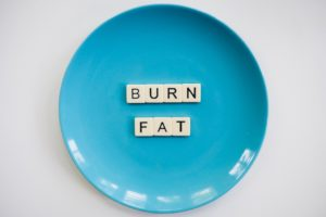 Blue plate with the words burn fat.