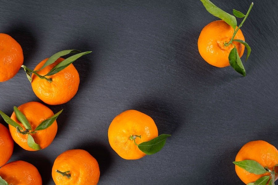 oranges on a grey background