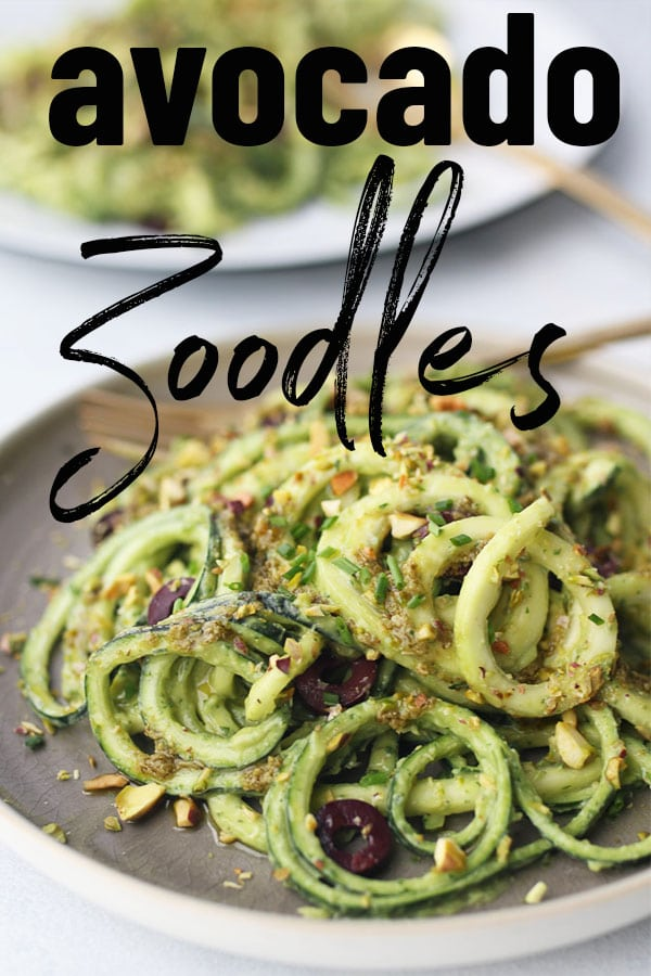 Zucchini noodles on a grey plate.