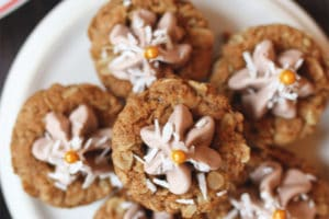 Pile of cookie cups on a white plate.