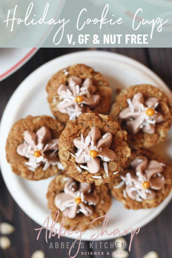Pile of oatmeal cookie cups on a white plate with chocolate mousse