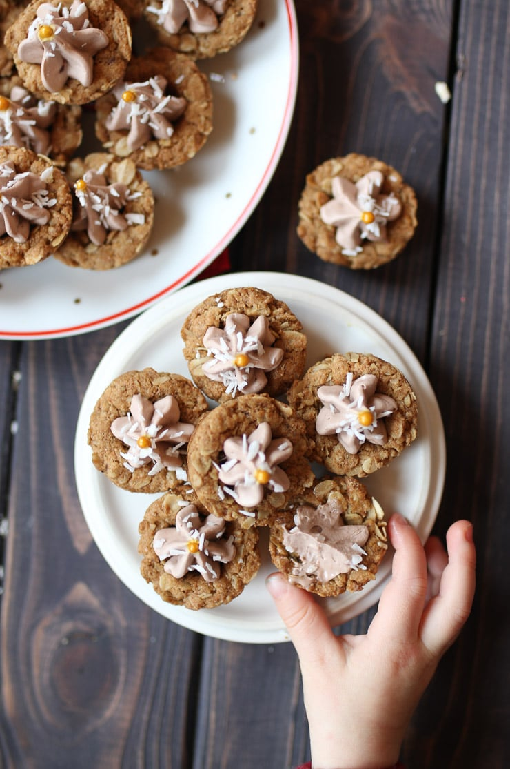 Toddler's hand reaching for oatmeal cookie cups.
