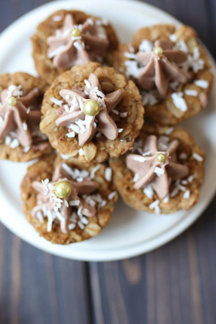 Pile of cookies on a white plate.