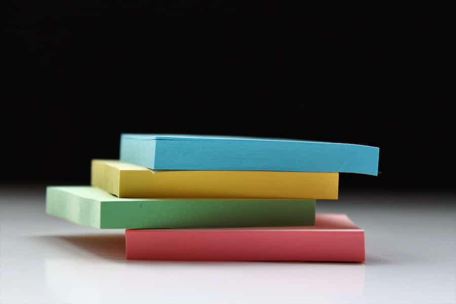 Stack of sticky notes for intuitive eating homework.