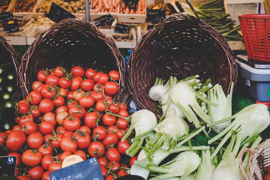 Tomatoes and fennel at a market.