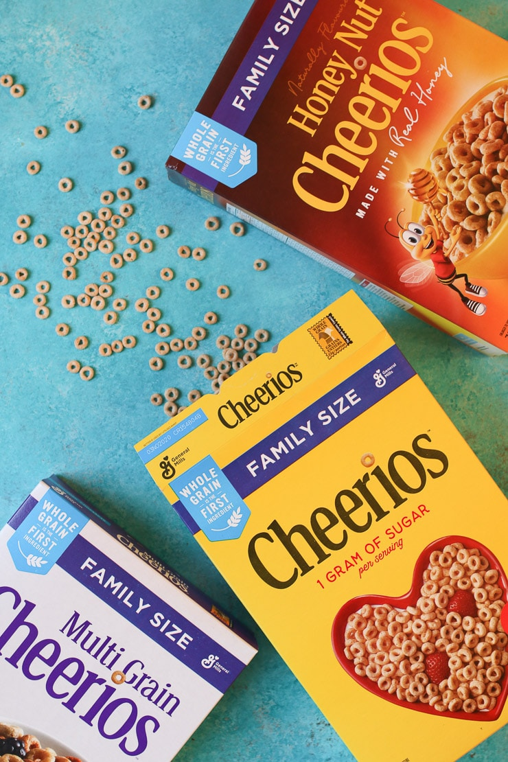 three cheerios boxes on a blue background