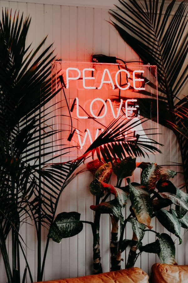 Neon sign about making peace with intuitive eating.