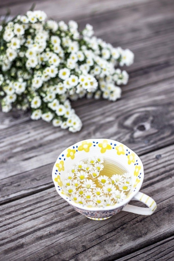 Chamomile tea in a mug for bloating