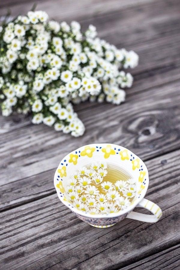 Chamomile tea in a mug for bloating