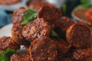 close up of gluten free family friendly lentil vegan meatloaf muffins garnished with fresh herbs