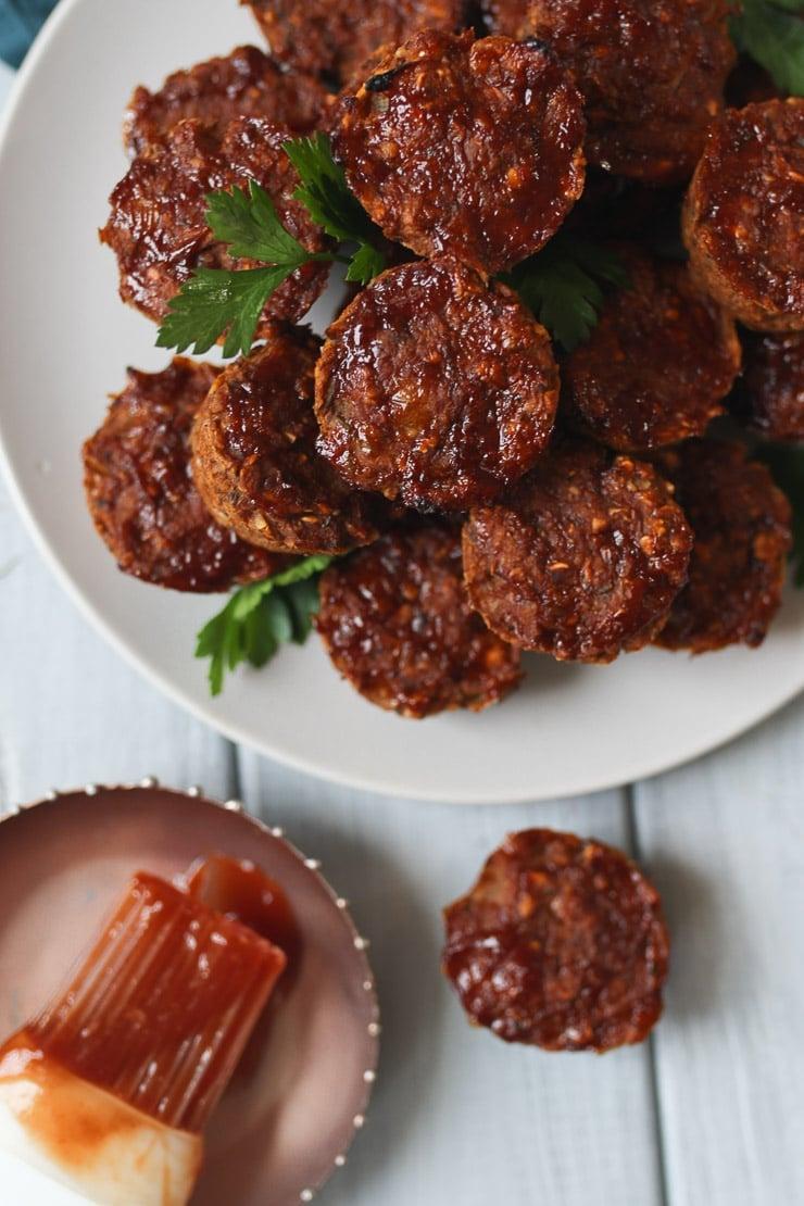 Mini vegan lentil meatloaf muffins on a white plate.