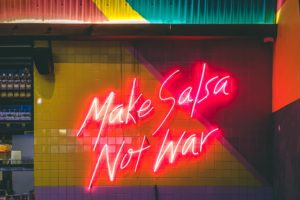 Neon sign about making peace with food.