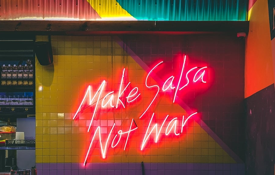 Neon sign about making peace with food in intuitive eating.