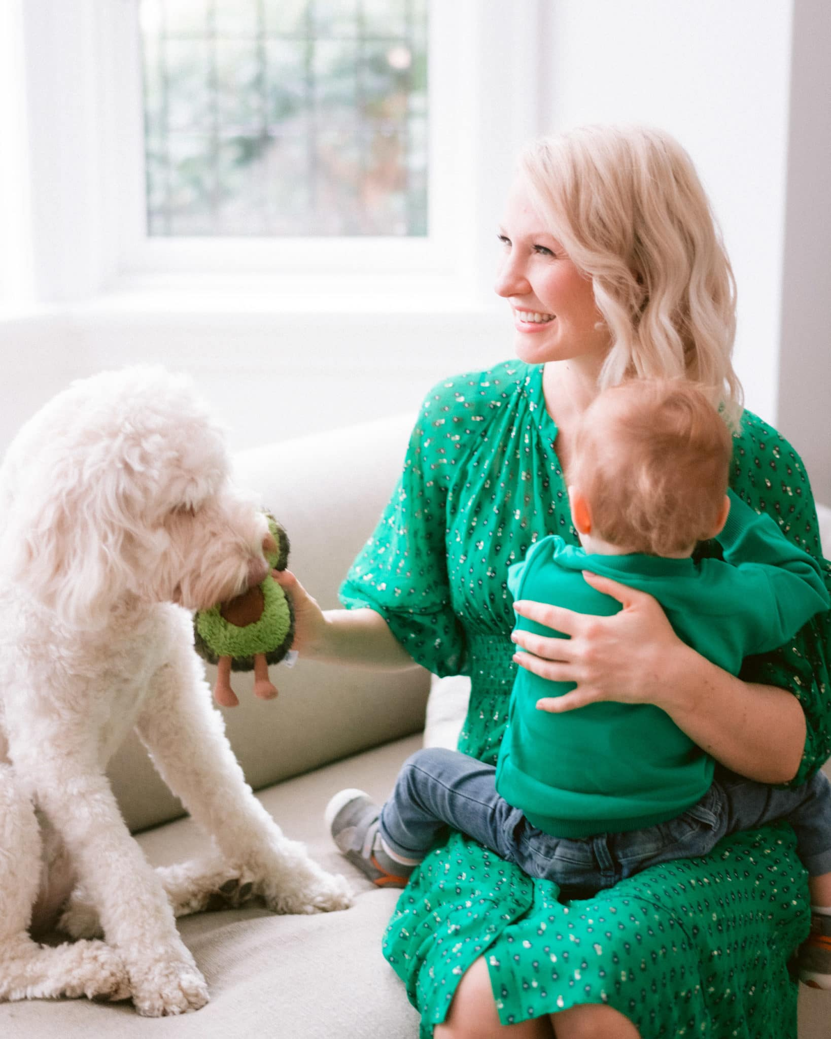 Abbey in a green dress with baby E and poppy