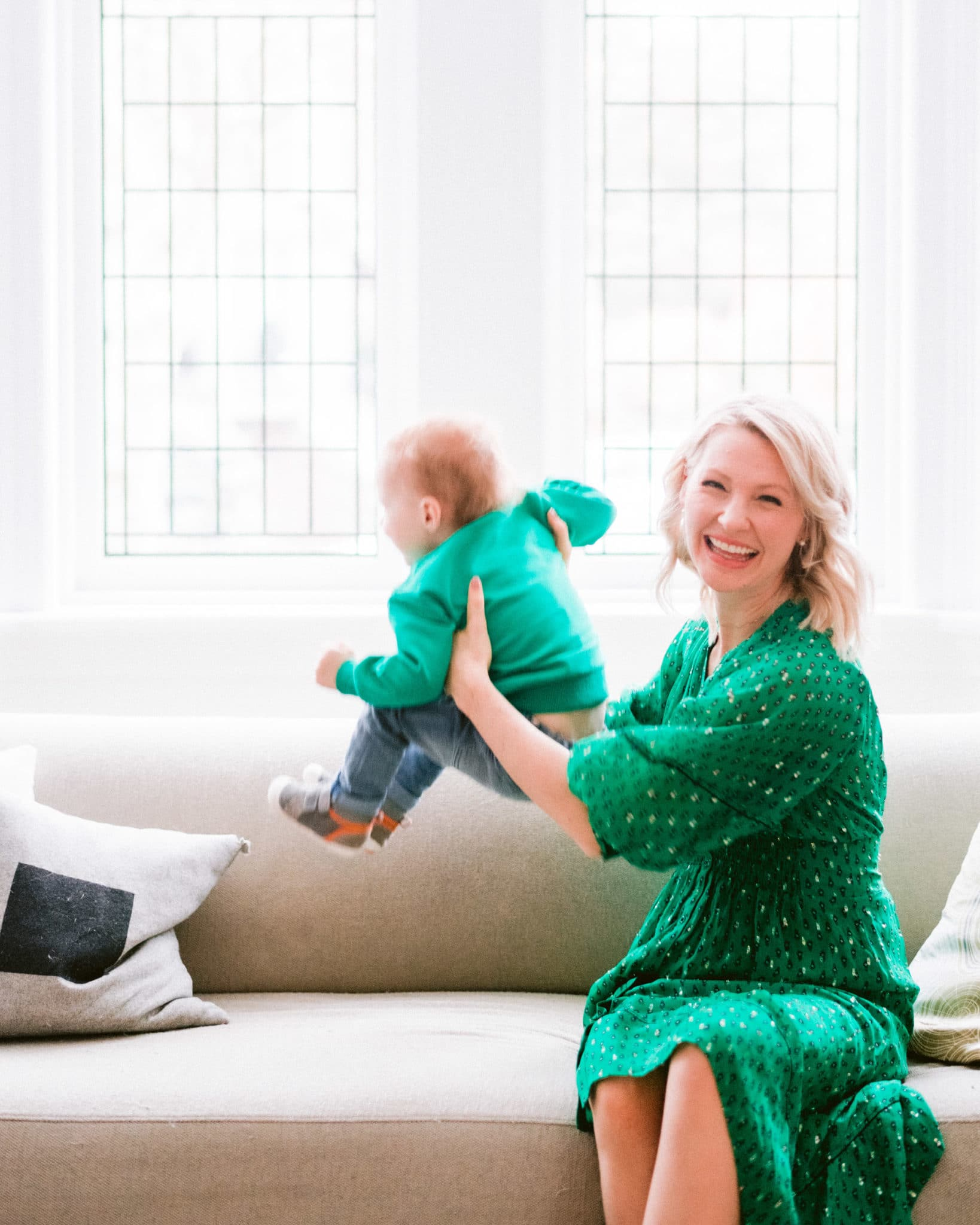 pregnant abbey in green dress lifting baby E