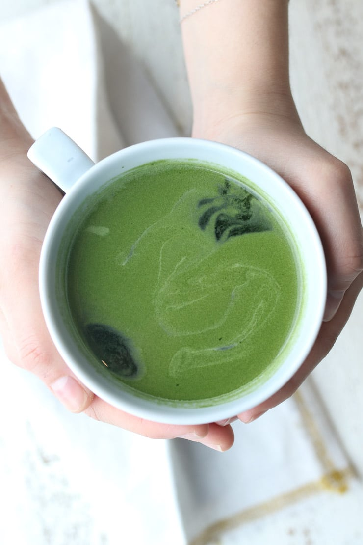birds eye view of a white mug containing green tea for a heart healthy diet