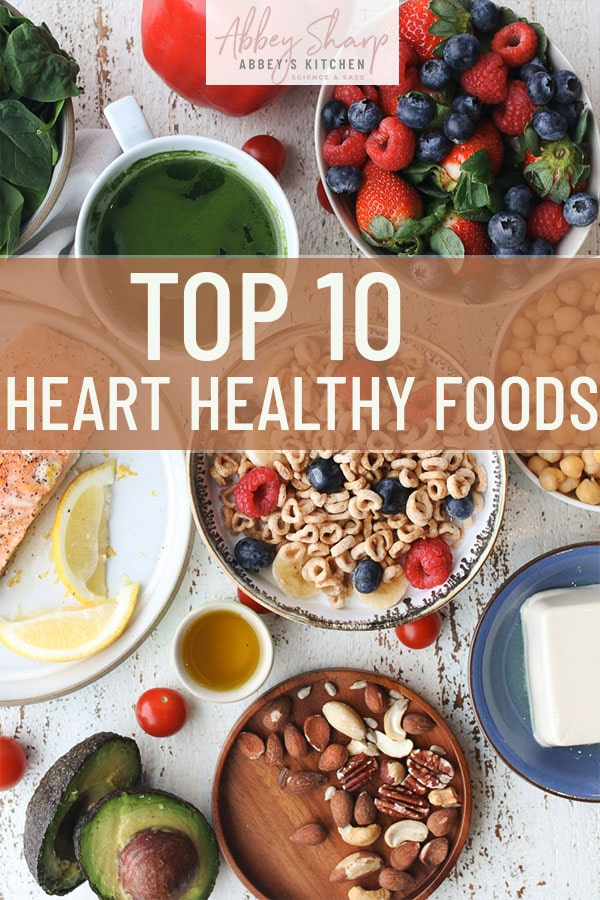 pinterest image of birds eye view of foods for a heart healthy diet with text overlay