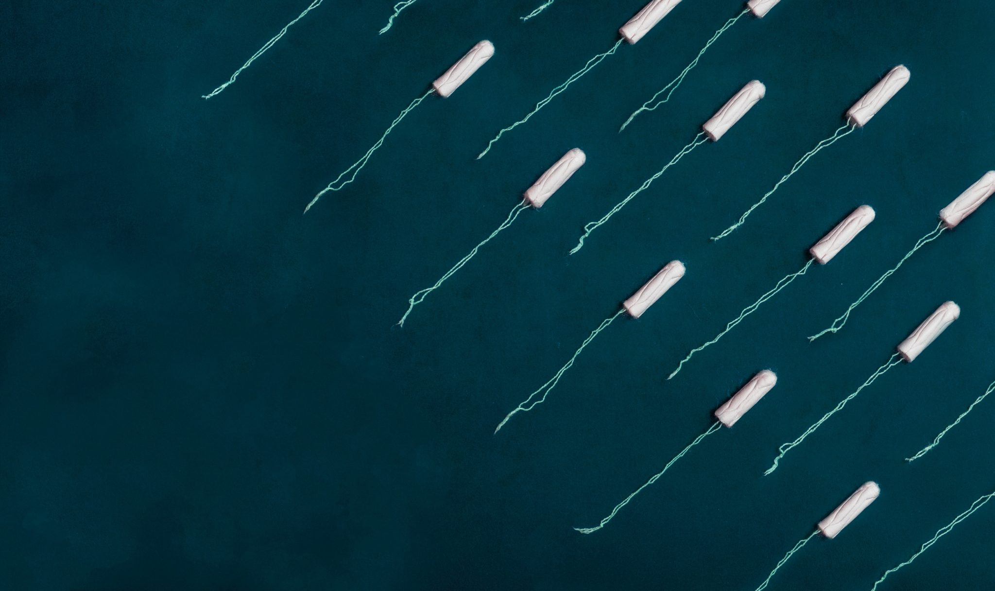 birds eye view of multiple tampons laid out on a dark background