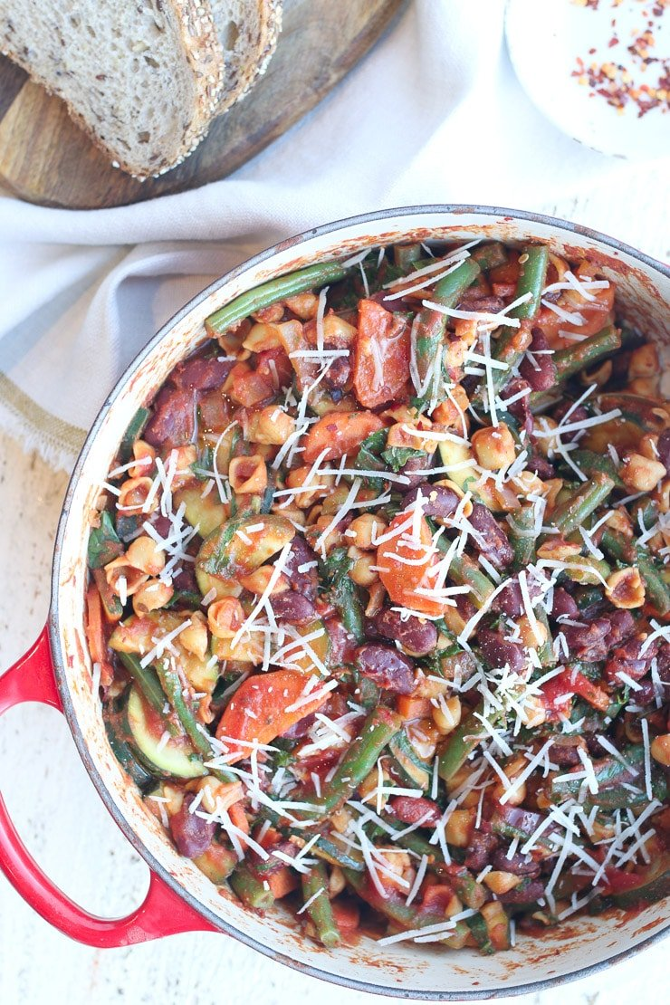 birds eye view of vegan minestrone skillet pasta on a red pot