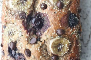 close up birds eye view of moist dairy free chocolate chip banana bread garnished with hemp seeds