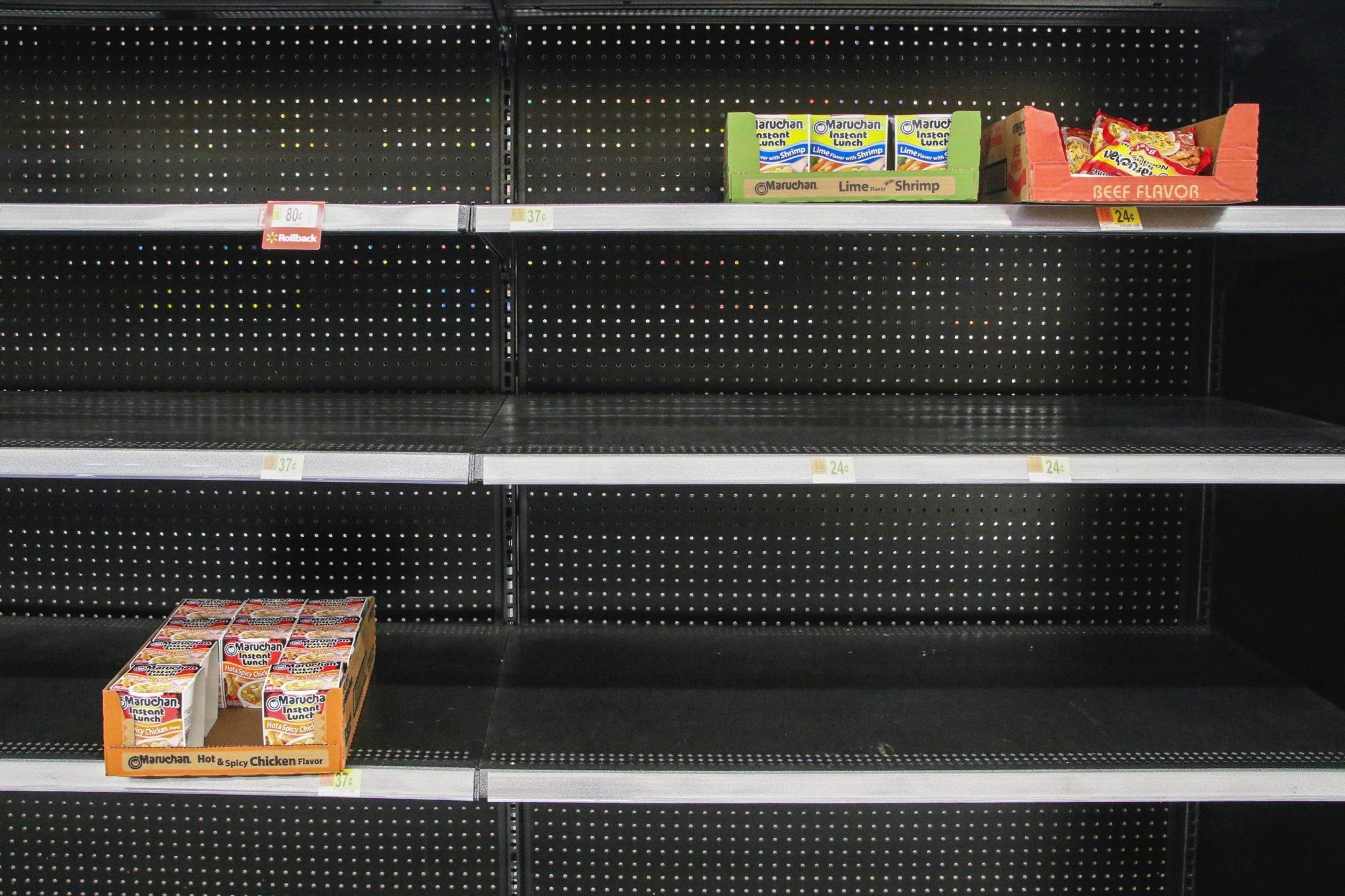 depleted grocery store shelves during coronavirus isolation