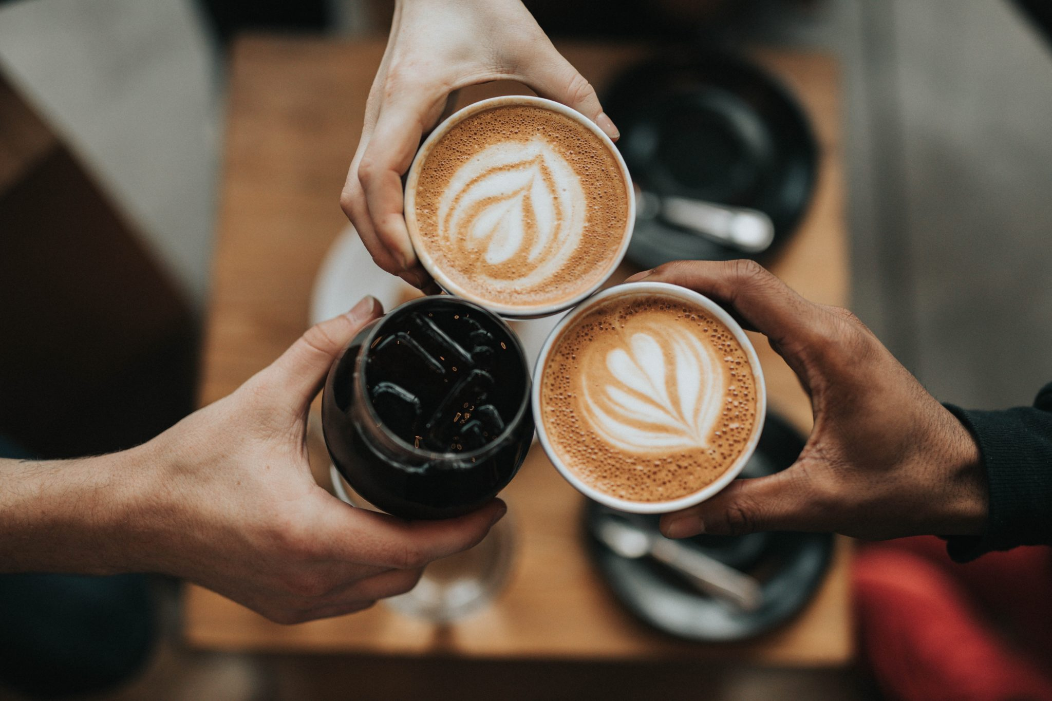 three caffeinated beverages held in the centre