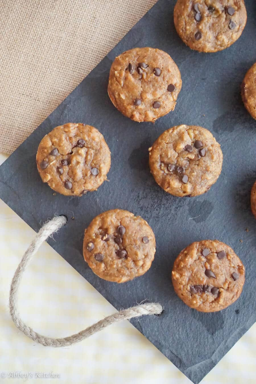 chocolate chip banana muffins on a grey tray using pantry staples