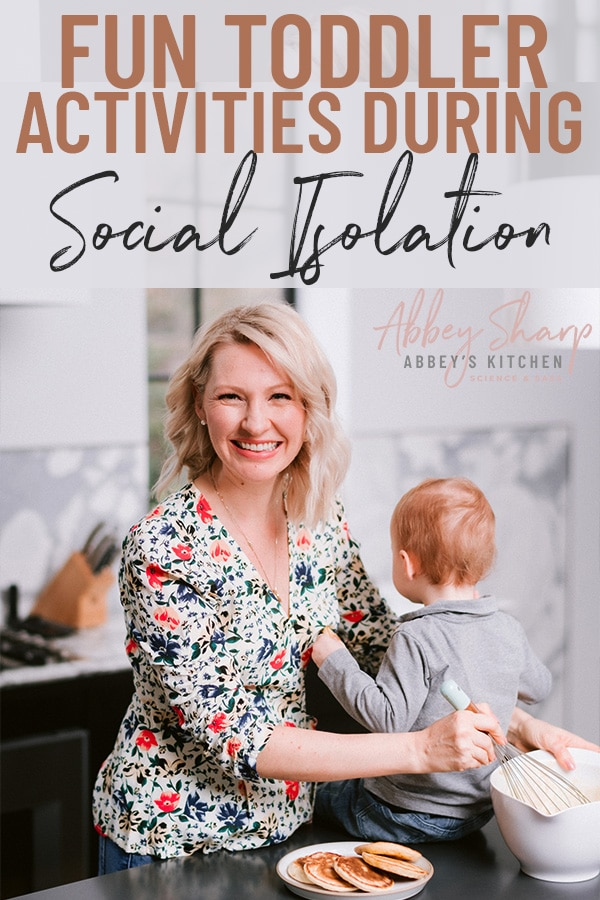 pinterest image of abbey and baby E in the kitchen making pancakes and engaging in toddler activities with text overlay
