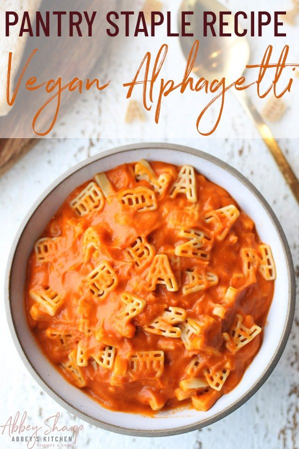 pinterest image of vegan one pot hidden vegetable alphagetti meal in a white bowl next to a gold spoon with text overlay