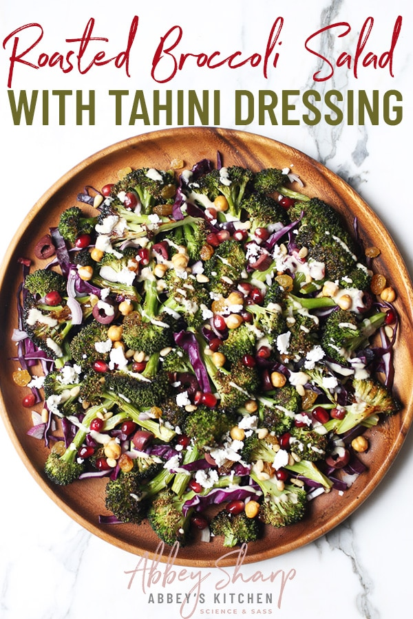 pinterest image of birds eye view of roasted broccoli salad with tahini dressing with text overlay