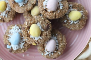 close up image of no bake easter themed mini egg granola cups garnished with shredded coconut