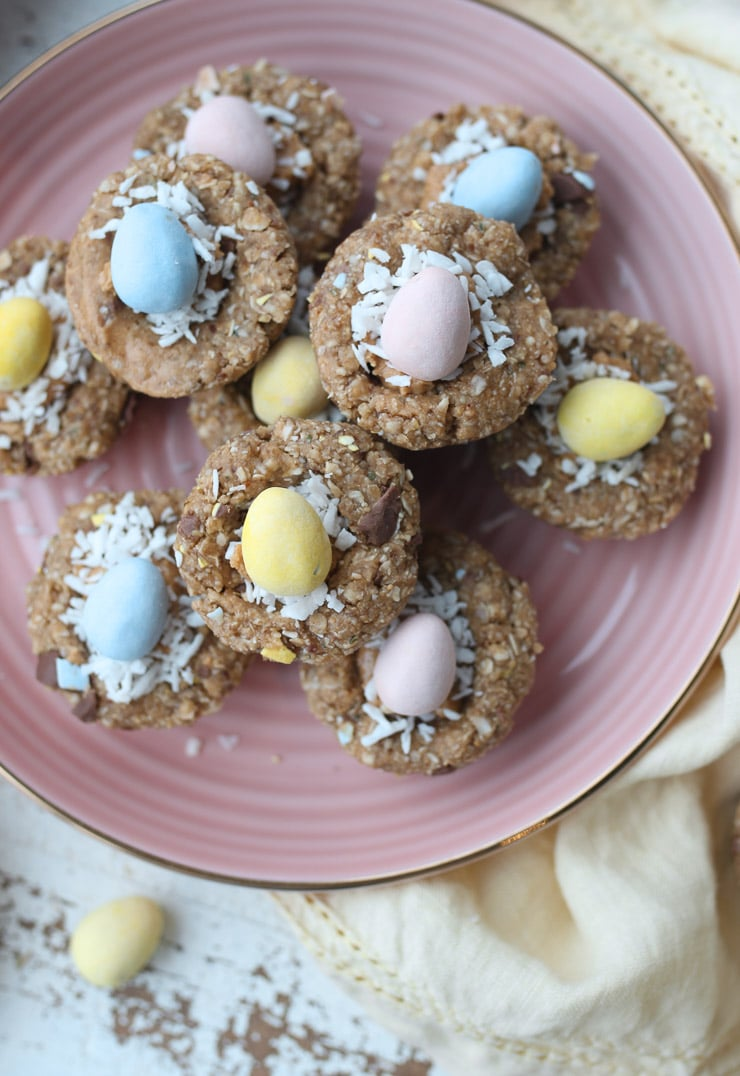mini egg easter themed snack cups made with granola stacked on a pink plate