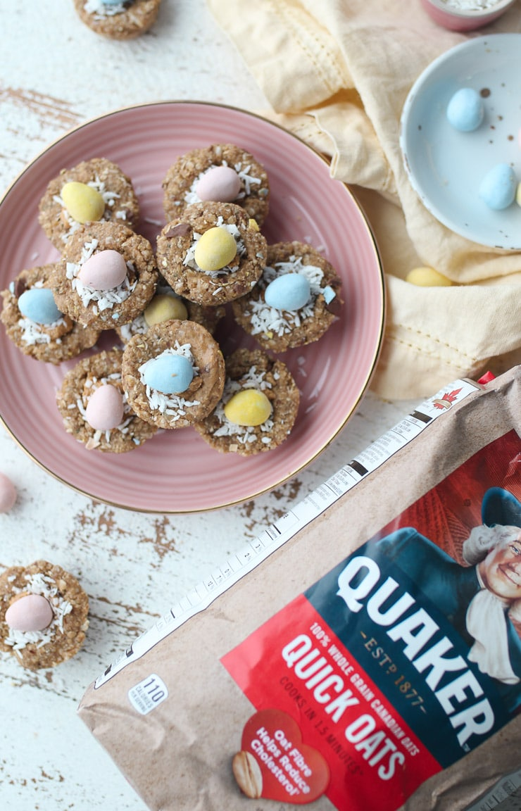 birds eye image of pantry staple easter inspired mini egg granola cups on a pink plate next to a bag of quaker oats