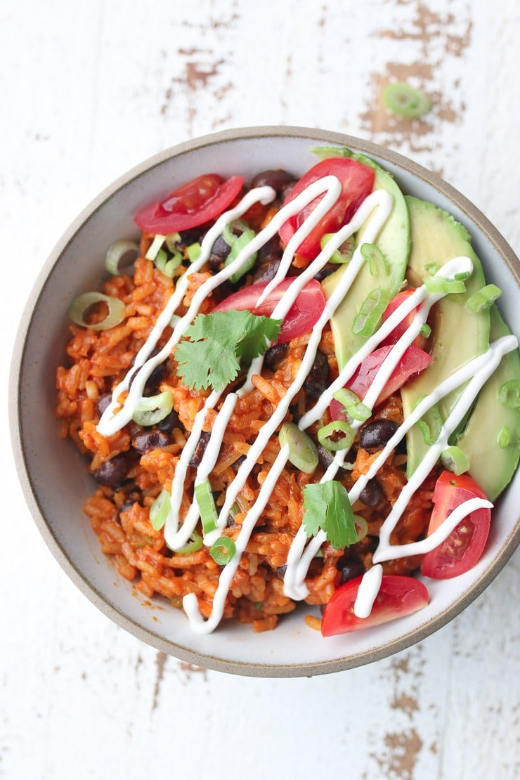 birds eye view of enchilada bowl drizzled with sour cream.