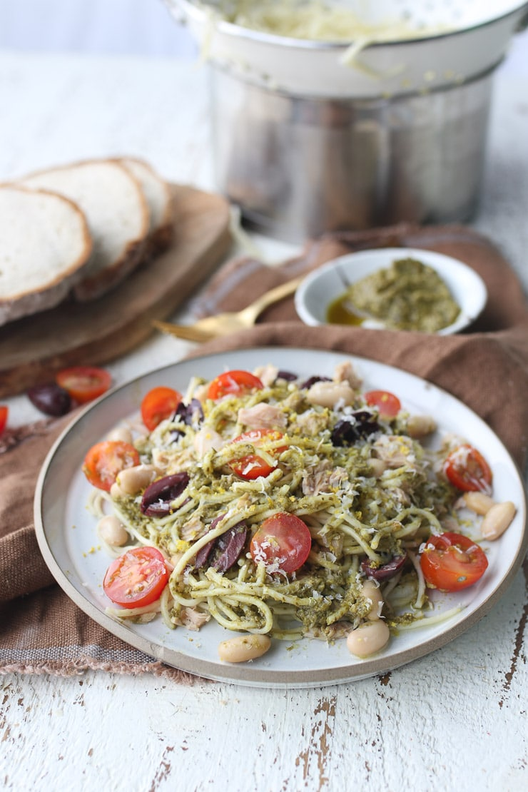 pesto pasta with tuna on a white plate