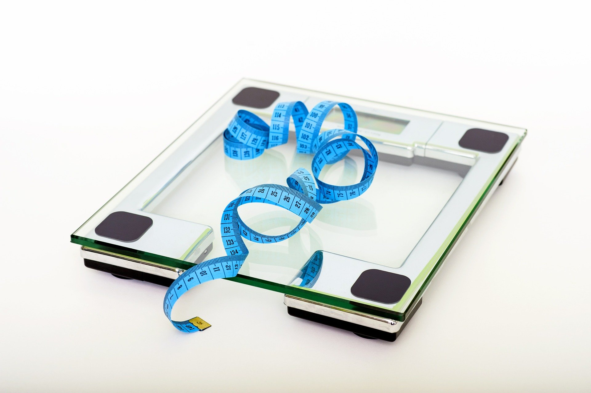 measuring tape and scale to track bariatric surgery results