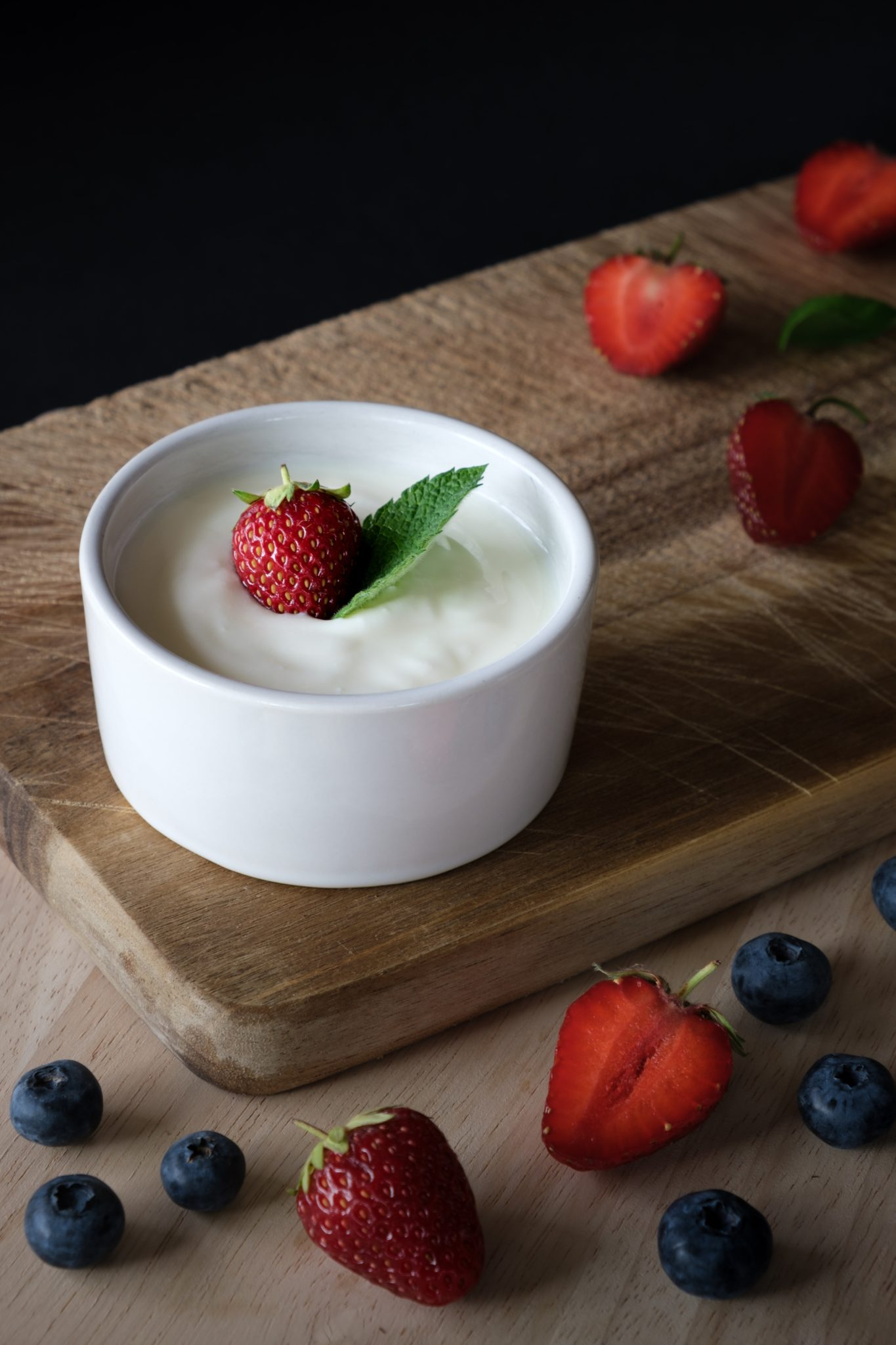 yogurt that contains probiotics for kids in white bowl with berries