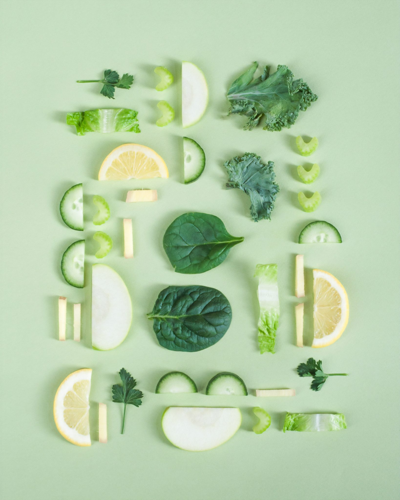 a variety of vegetables like lemon, cucumber and apple cut into moon shapes