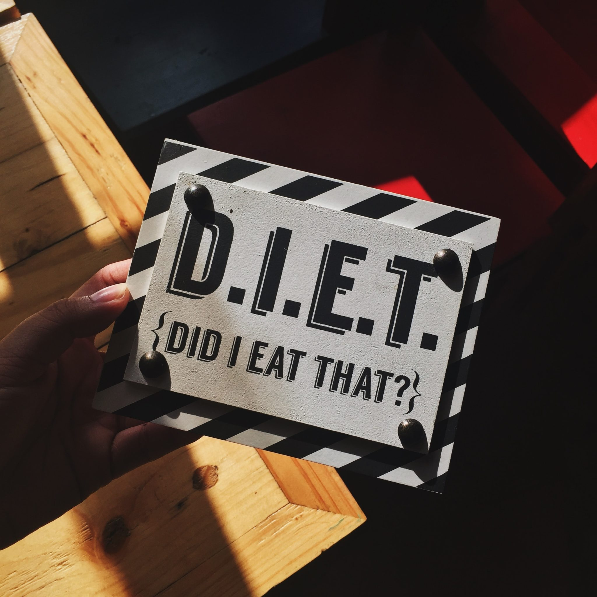 "a sign that says ""DIET"" as an acronym for ""Did I Eat That?"""