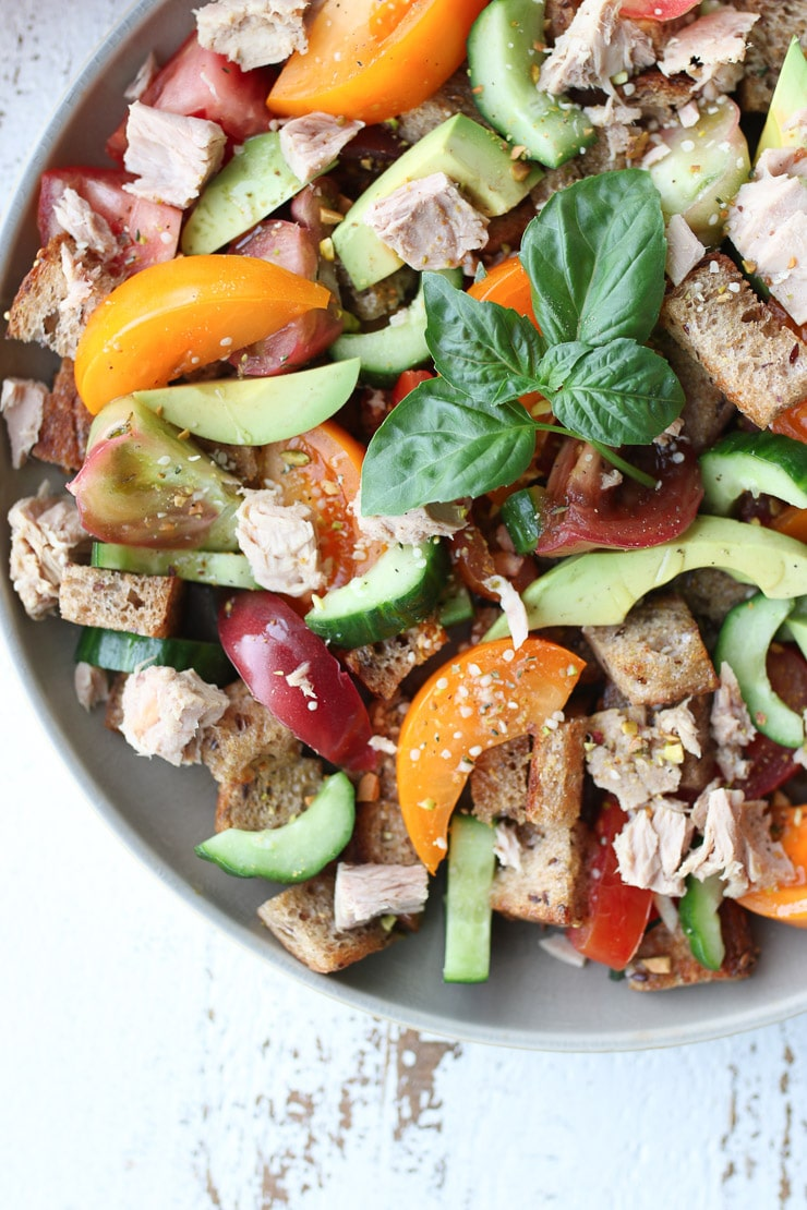 close up of panzanella salad with tuna and avocado