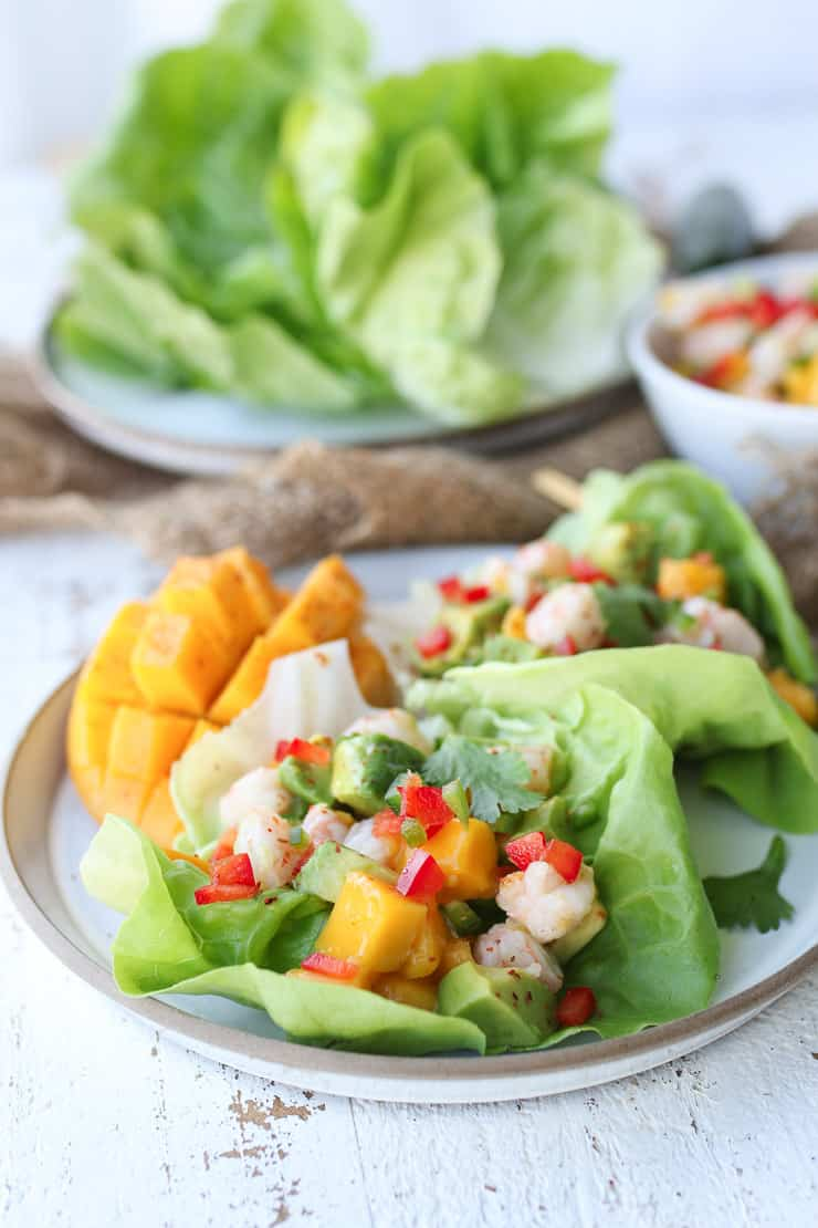 shrimp salad with mango on a white plate