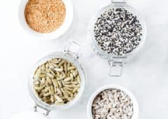 several seeds in jars for seed cycling