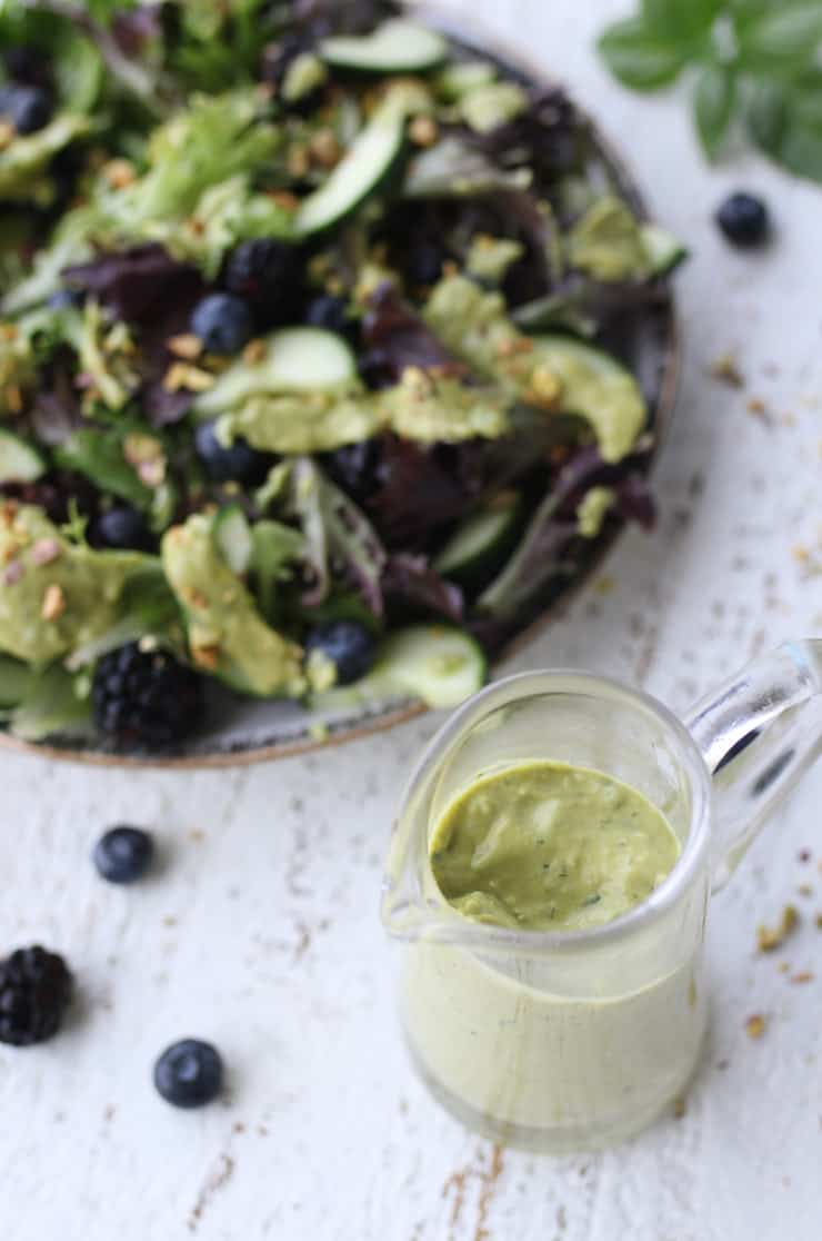 birds eye view of avocado salad dressing with salad in the background