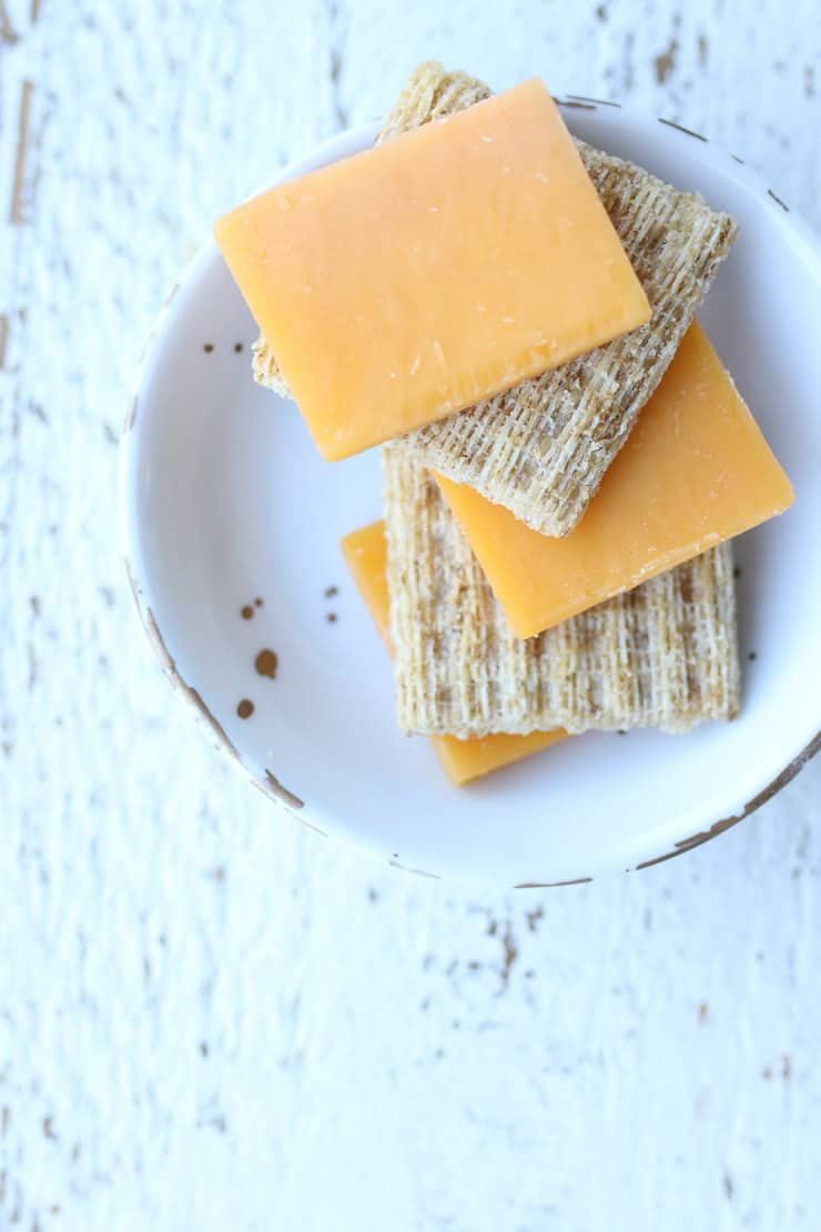 whole grain crackers and cheese on a white plate