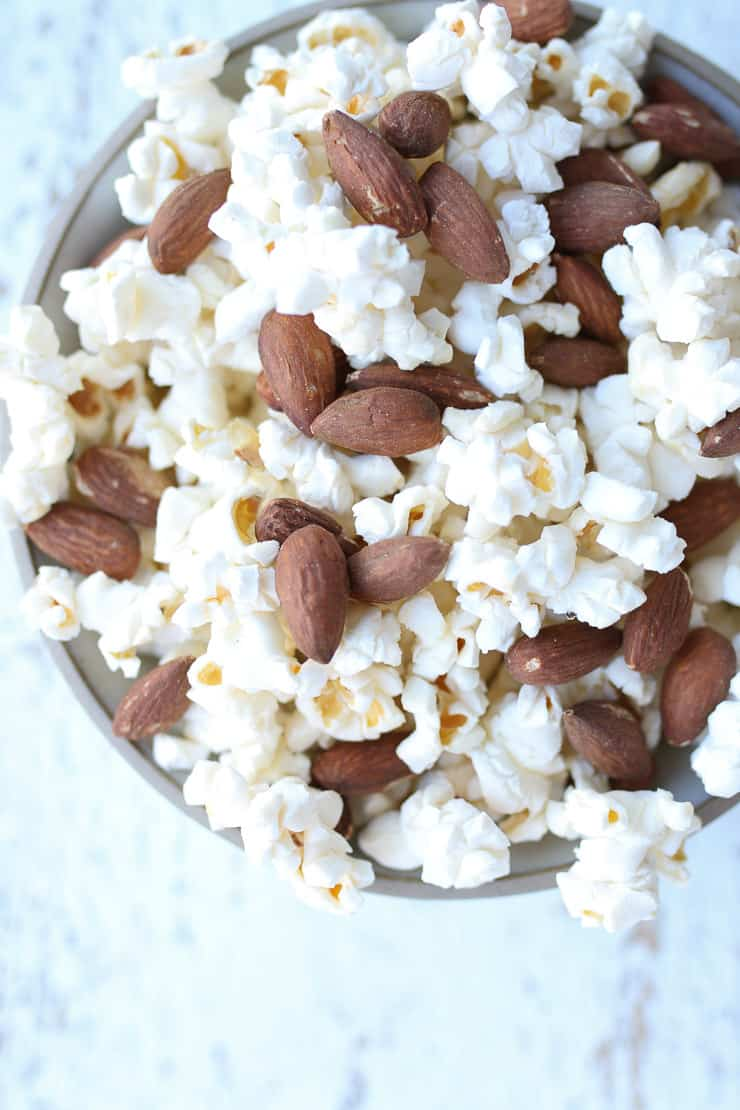 popcorn and almonds mixed together for a healthy snack to manage blood sugar levels