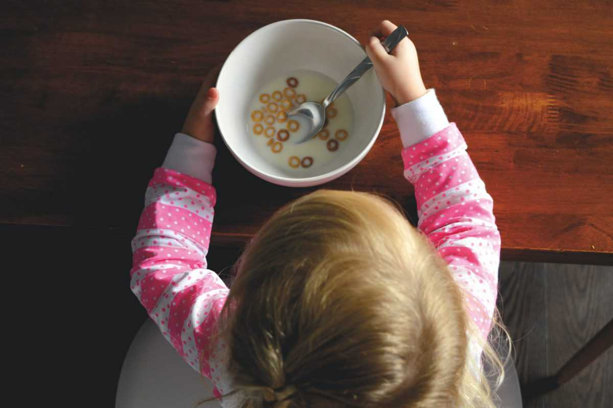 birds eye view of child eating cereal