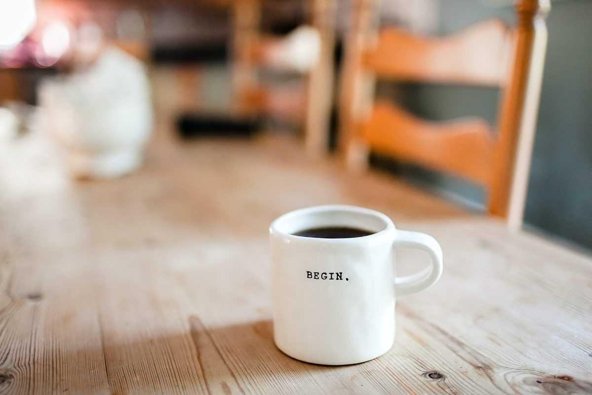 A white coffee mug with caffeine.