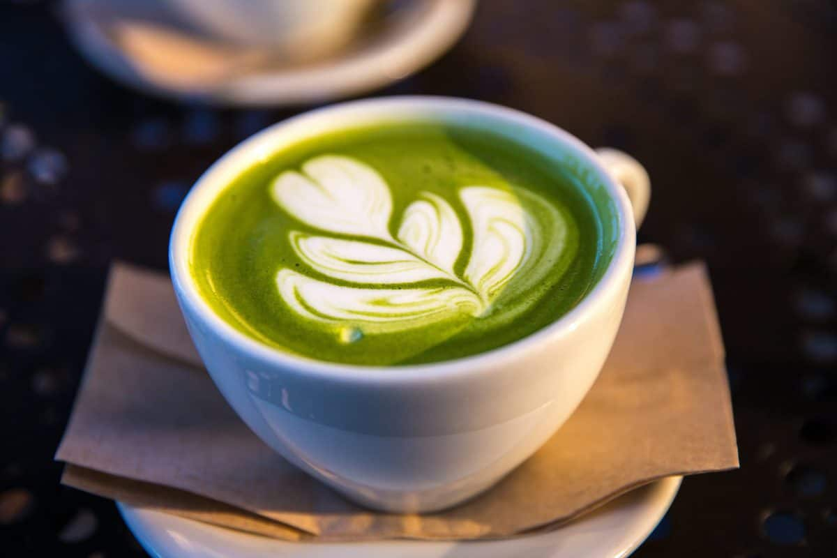 matcha latte in a white mug with caffeine