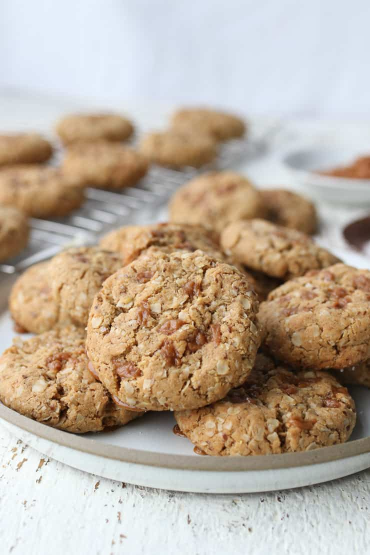 salted toffee cookies on a white plate